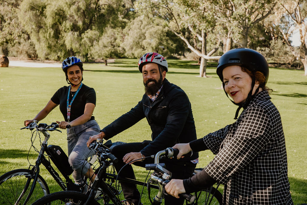 3 Staff testing out our new E Bikes